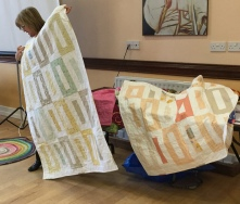 two quilts made from a Jelly Roll