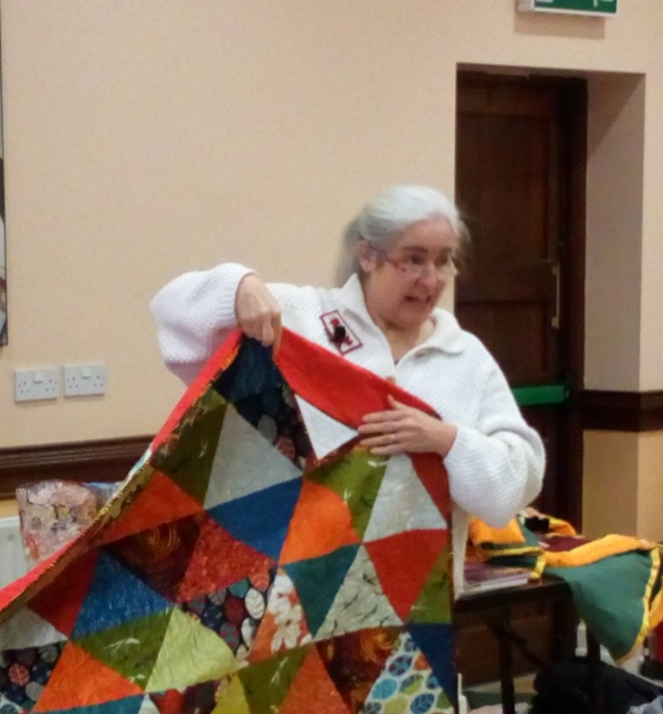 Frances is extremely pleased to find Cora's quilt is labelled!