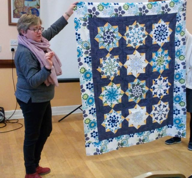 Eilis Watson showed what a larg print can do with the kaleidoscope pattern. The centre kaleidoscopes are all cut from the same large print used for the border!