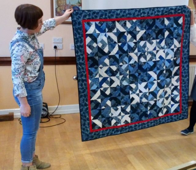 Strip quilt in blues by Mary Palmer