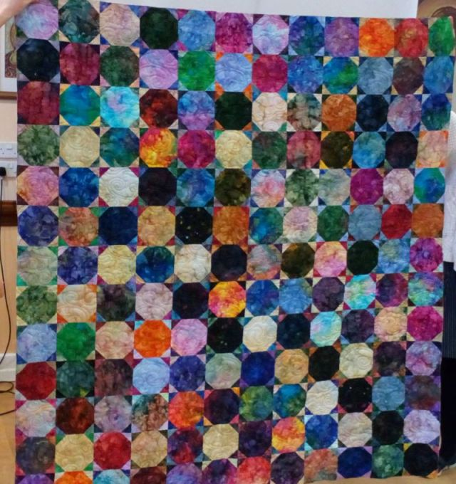 Mary Plamer's batik snowball quilt. It will be bound soon...